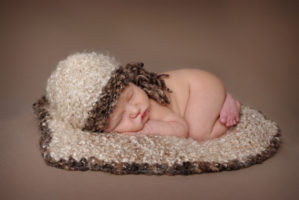 Newborn baby portrait session in both natural light and studio light